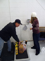 Mike and Nathalie weighing the goods